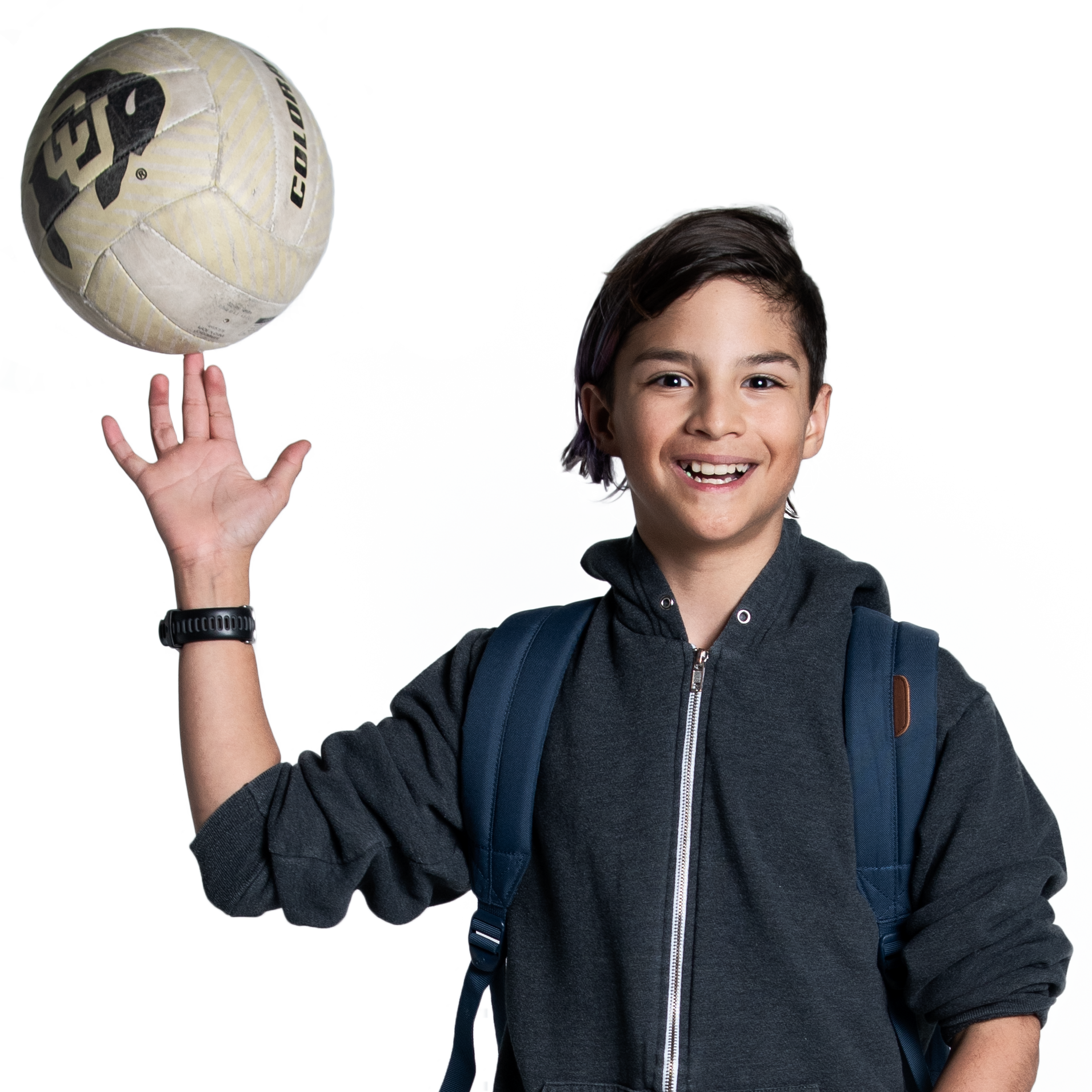 Nicco, a middle school student with a volleyball